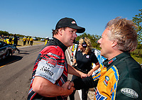 Apr 14, 2019; Baytown, TX, USA; NHRA mountain motor pro stock driver John DeFlorian (right) is congratulated by J.R. Carr after winning the Springnationals at Houston Raceway Park. Mandatory Credit: Mark J. Rebilas-USA TODAY Sports