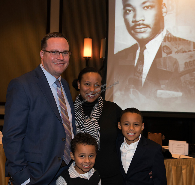 Derek Markie, Danielle Pugh-Markie, six-year-old Theo and MLK Essay winner eight-year-old Miles during the 29th Annual Dr. Martin Luther King, Jr. Dinner Celebration at the Atlantis Casino Resort Spa in Reno, Monday night, Jan. 16, 2017.