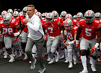 Urban Meyer takes the field before the OSU game with Tulane at Ohio Stadium September 22, 2018.[Eric Albrecht/Dispatch]