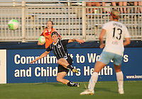 Rebecca Moros #19 of the Washington Freedom crosses the ball past Natalie Spilger #13 of the Chicago Red Stars during a WPS match at the Maryland Soccerplex, in Boyds Maryland on June 12 2010. The game ended in a 2-2 tie.