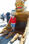 """Torrington, CT 051819MK04 Diego DelNegro , Two years old from Torrington, plays in the business end of an excavator at the O&G Industries' annual Touch a Truck Family Fun Event at their maintenance facility on Saturday Morning.  Seth Duke, marketing director, said """" With the weather so nice today we will receive over two-thousand attendees and the suggested donations will be donated to Kids Play to help with their continued development.""""  O&G's Jim Zambero, vice president of equipment purchase and maintenance, said that sixty volunteers and twenty-five local vendors helped host the event while members of the Operational Engineer's Union Local #478 directed traffic and managed parking . Michael Kabelka / Republican-American"""