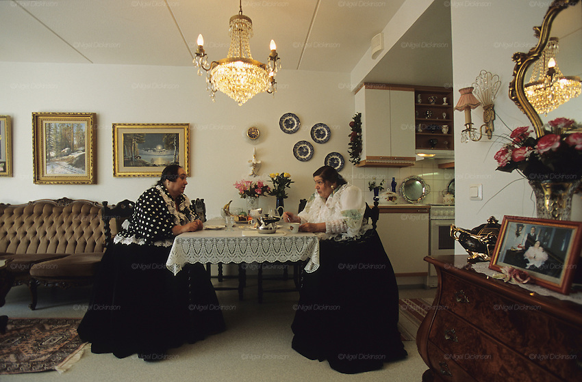 Mother's day celebration at Mrs Gronfer's home. Finnish Roma are amongst the most traditional. Roma girls have to chose whether to wear traditional Roma dress. Their velvet skirts weigh around 10 kilos. If they wear western style clothes, even once, they are not allowed to revert back to traditional clothes. Helsinki, Finland 2005