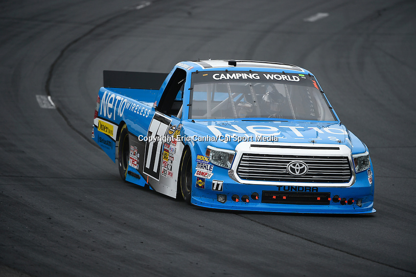 September 19, 2014 - Loudon, New Hampshire, U.S. - German Quiroga, NASCAR Camping World Truck Series driver of the #77 Net10 Wireless Toyota truck races during the NASCAR Camping World Truck Series UNOH 175 race held at the New Hampshire Motor Speedway in Loudon, New Hampshire.   Eric Canha/CSM