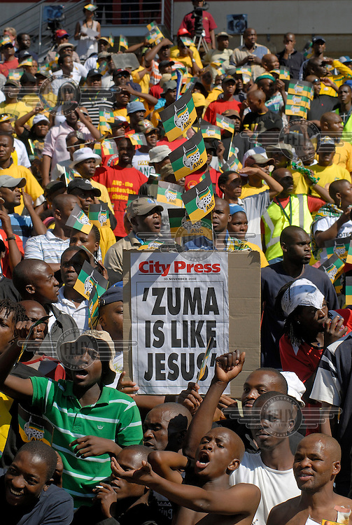 """A newspaper headline proclaims: """"Zuma is like Jesus"""", at an African National Congress (ANC) election rally held at the Ellis Park Stadium in Johannesburg.."""