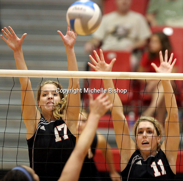 University of Nebraska-Omaha's Brittany Hanssen (left) and Kelli Goeser (right) go up for a block. Goeser had 11 kills to lead UNO to a three-set sweep over North Alabama. (Photo by Michelle Bishop)..