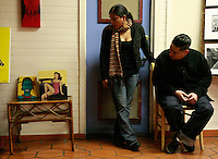 Artist Selina Calvo disscusses her work with Julian Vazquez at her exhibition outside Infectious Threads in Ocean Beach during the Newport Nights Art Happening, Saturday January 26, 2008.