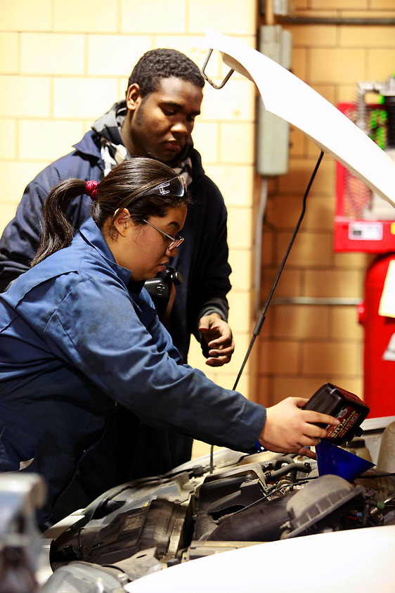 Automotive HS, Brooklyn, NY on Friday, January 22, 2010.  High school students have the opportunity to participate in a special program where they perform basic maintenance and repairs on privately owned cars at very competitive prices.  Students Naomi Saez, 17, left, and Kenny Ramdwar, 17, change the oil of a car.