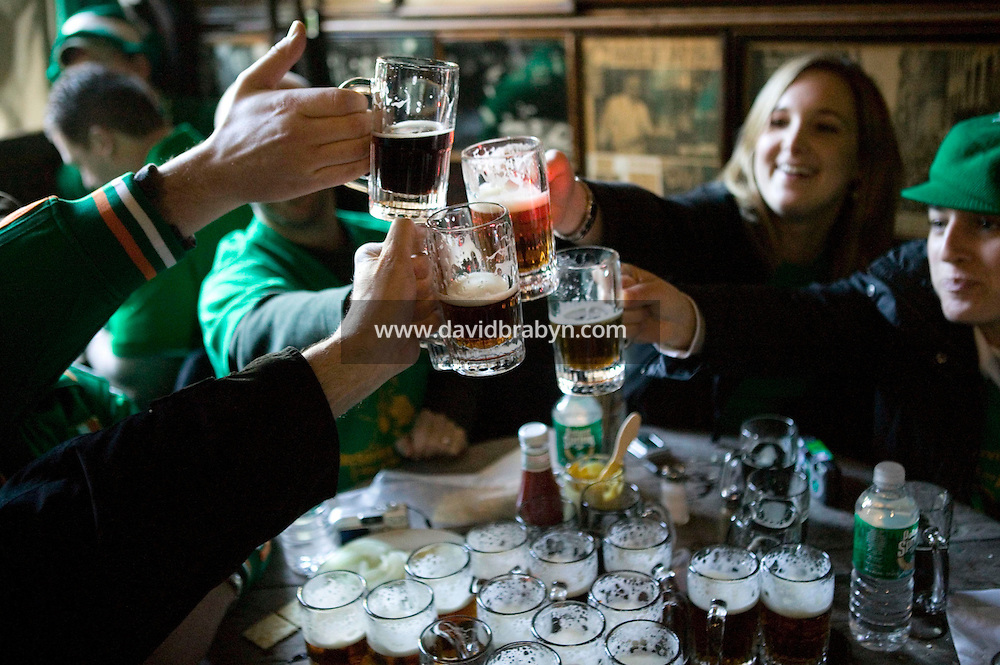 17 March 2006 - New York City, NY - People celebrate St Patrick's day at McSorley's pub in New York City, 17 March 2006. Every year McSorley's, one of New York's most famous Irish pubs, opens - and fills up immediately - at 8am on St Patrick's day.