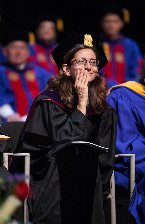 Jennifer Rosato Perea, incoming Dean, listens to remarks as the DePaul University College of Law held its commencement ceremony on May 17, 2015 at the Rosemont Theatre in Rosemont, IL, where some 280 students received their Juris Doctors or Master of Laws degrees. The Rev. Dennis H. Holtschneider, C.M., president of DePaul, conferred the degrees. M. Cherif Bassiouni, DePaul emeritus professor of law, addressed the graduating class and received an honorary degree. (DePaul University/Jeff Carrion)