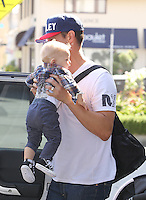 SANTA MONICA, CA - MAY 10: Josh Duhamel and son Axel doing last-minute mother's day shopping for Fergie in Santa Monica, California on May 10, 2014. Credit: SP1/Starlitepics /NortePhoto