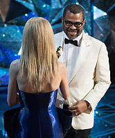 Nicole Kidman presents the Oscar&reg; for Best Original Screenplay to Jordan Peele for work on &ldquo;Get Out&rdquo; during the live ABC Telecast of The 90th Oscars&reg; at the Dolby&reg; Theatre in Hollywood, CA on Sunday, March 4, 2018.<br /> *Editorial Use Only*<br /> CAP/PLF/AMPAS<br /> Supplied by Capital Pictures