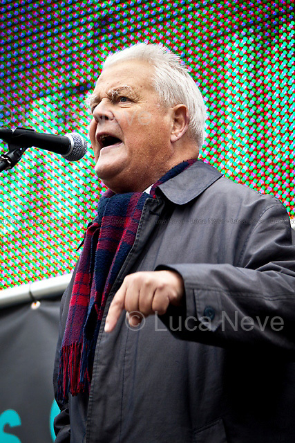 Bruce Kent (British political activist, former Roman Catholic priest and active in the Campaign for Nuclear Disarmament - CND).<br /> <br /> London, 08/10/2011. Today Trafalgar Square was the stage of the &quot;Antiwar Mass Assembly&quot; organised by The Stop The War Coalition to mark the 10th Anniversary of the invasion of Afghanistan. Thousands of people gathered in the square to listen to speeches given by journalists, activists, politicians, trade union leaders, MPs, ex-soldiers, relatives and parents of soldiers and civilians killed during the conflict, and to see the performances of actors, musicians, writers, filmmakers and artists. The speakers, among others, included: Jeremy Corbin, Joe Glenton, Seumas Milne, Brian Eno, Sukri Sultan and Shadia Edwards-Dashti, Hetty Bower, Mark Cambell, Sanum Ghafoor, Andrew Murray, Lauren Booth, Kate Hudson, Sami Ramadani, Yvone Ridley, Mark Rylance, Dave Randall, Roger Lloyd-Pack, Rebecca Thorn, Sanasino al Yemen, Elvis McGonagall, Lowkey (Kareem Dennis), Tony Benn, John Hilary, Bruce Kent, John Pilger, Billy Hayes, Alison Louise Kennedy, Joan Humpheries, Jemima Khan, Julian Assange, Lindsey German, George Galloway. At the end of the speeches a group of protesters marched toward Downing Street where after a peaceful occupation the police made some arrests.