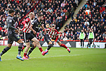 Billy Sharp of Sheffield Utd heads in the first goal during the Premier League match at Bramall Lane, Sheffield. Picture date: 7th March 2020. Picture credit should read: Alistair Langham/Sportimage