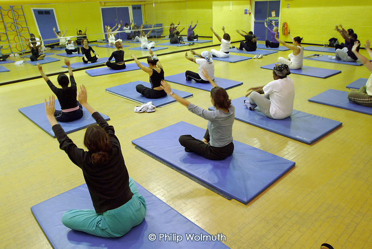 Pilates class during the weekly Women's Sports Evening at the Westminster Council Moberley Sports Centre, Kensal Rise, West London.