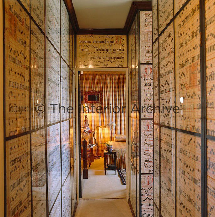 Musical manuscripts line the walls of this narrow hallway leading to the bedroom