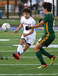 WATERBURY  CT. - 14 October 2019-101419SV09- #1 Saul Pujols of Naugatuck High clears a ball past #9 Luciano D'Amelio of Holy Cross High during NVL Soccer action in Waterbury Monday. <br />Steven Valenti Republican-American