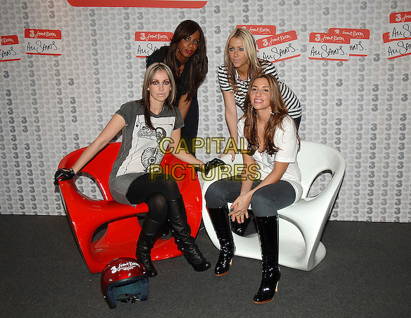 NATALIE APPLETON, SHAZNAY LEWIS, NICOLE APPLETON & MELANIE BLATT.Recently reunited girl group All Saints play live for first time since reforming to promote their new single Rock Steady at The Pavillion on Shepherd's Bush Green in London. The gig is for 3FrontRoom, a series of concerts made available to fans via their video mobile phones..October 25th, 2006.Ref: BEL.full length sitting gloves grey gray dress boots white black sisters siblings.www.capitalpictures.com.sales@capitalpictures.com.©Tom Belcher/Capital Pictures.