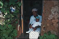 Rose and her four-year-old daughter Esther. Korongocho slum, Kenya.
