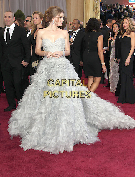 Amy Adams (wearing Oscar de la Renta).85th Annual Academy Awards held at the Dolby Theatre at Hollywood & Highland Center, Hollywood, California, USA..February 24th, 2013.oscars full length dress gown powdery blue fluffy layers layered feathery tulle train strapless profile .CAP/ADM/RE.©Russ Elliot/AdMedia/Capital Pictures.