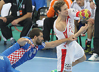 25.01.2013 Barcelona, Spain. IHF men's world championship, Semi-final. Picture show Kasper Sondergaard Sarup  in action during game between Spain vs Slovenia at Palau St. Jordi