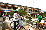 Children at a school in the rural highlands district of A Luoi, Vietnam ride bicycles given to them by war veteran Mark Oconnor. The 63-year-old from Sioux Falls, S.D. recently gave away 55 bicycles to poor children at two schools in the district and plans to give away at least 200 more next year. Many children live more than six miles from school, he said, and without the bicycles they would not be able to attend classes every day.  April 21, 2014.