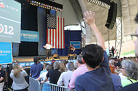 A crowd member waves to Senate hopeful and former Governor Virginia Tim Kaine before rock legend Bruce Springsteen rallied support for President Barack Obama during a free concert held Tuesday afternoon at the nTelos Wireless Pavilion in Charlottesville, Va.