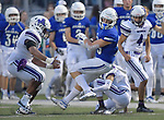 Columbia wide receiver Sam Horner (center) spins and breaks away from three would-be Mascoutah tacklers. Columbia played Mascoutah on Saturday August 31, 2019 in a football game that was never started on Friday night due to bad storms.<br /> Tim Vizer/Special to STLhighschoolsports.com