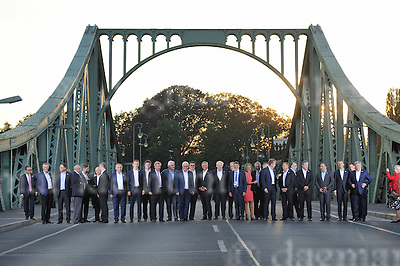 September 01-16,Potsdam,Brandenburg,Germany<br /> Informal OSCE Foreign Ministers&rsquo; Meeting in Potsdam<br /> German Foreign Minister Frank-Walter Steinmeier and participants of the meeting  wait for a photo,then walk across the Glienicker Bridge