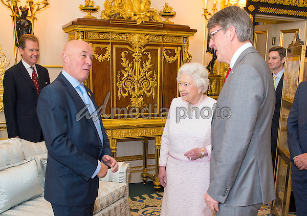 14 October 2016 - Windsor, Berkshire, UK - Queen Elizabeth II meets Red Cross Executive Director of Fundraising Mark Astarita (left) and Red Cross Chief Executive Michael Adamson (right), at the unveiling of a portrait of her by British artist Henry Ward, marking six decades of patronage to the British Red Cross, which has been unveiled at Windsor Castle in Berkshire. The Queen is the longest-serving patron of the charity, which supports people in crisis in the UK and overseas. Photo Credit: Alpha Press/AdMedia