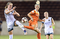 Houston, TX - Saturday July 08, 2017: Celeste Boureille and Rachel Daly battle for control of the ball during a regular season National Women's Soccer League (NWSL) match between the Houston Dash and the Portland Thorns FC at BBVA Compass Stadium.