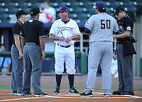 NWA Democrat-Gazette/ANDY SHUPE<br /> Northwest Arkansas Naturals manager Vance Wilson (center) and San Antonio Missions manager Rod Barajas meet Wednesday, Aug. 12, 2015, at home plate before the start of play at Arvest Ballpark in Springdale.