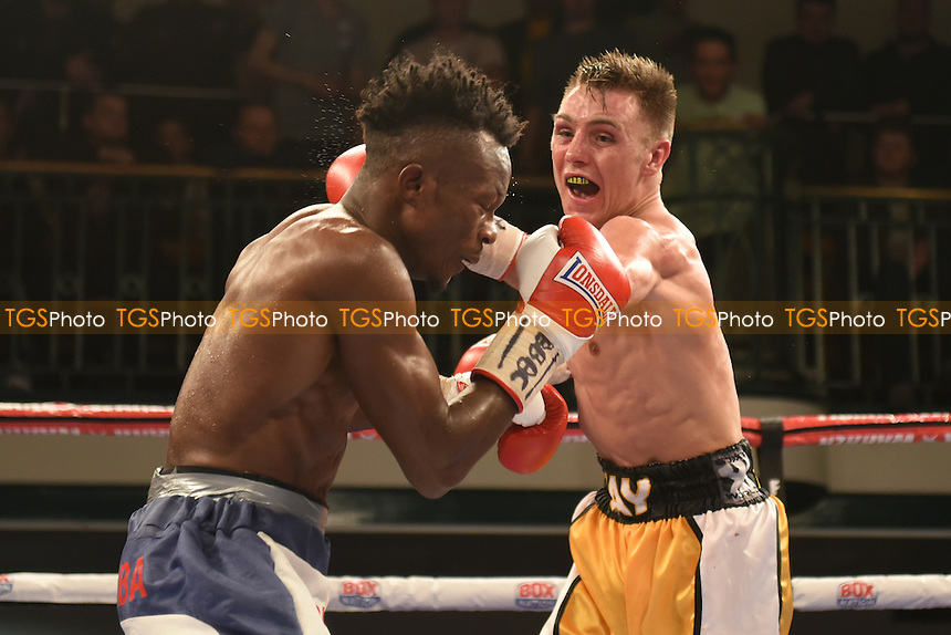 Jay Harris (yellow/white shorts) defeats Thomas Essomba to win the Commonwealth Flyweight Title during a Boxing Show at York Hall on 24th February 2017