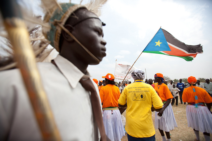 9 december 2010 - Juba, South Sudan - Traditional and cultural performers provide a traditional ceremonial dances during a rally in support of the independence referendum in Juba, South Sudan. According to South Sudanese officials, more than 2.8 million people have registered to vote in the referendum. The referendum on whether the oil-producing region should declare independence, scheduled for Jan. 9, is the climax of a 2005 peace deal that ended decades of north-south conflict - Africa's longest civil war that was fought over ethnicity, religion, ideology and oil and that killed 2 million people. Photo credit: Benedicte Desrus