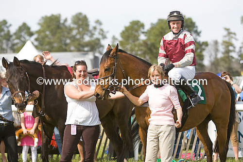 Flat Top (left) in winners circle with Bounding Cat, jockey Robbie Walsh, trainer Janet Elliot, and Allison Fulmer, Aiken Spring Races 2009.