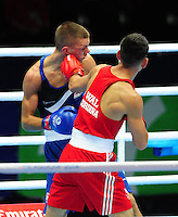 Wales' Joseph Cordina (red) defeats England's Pat McCormack (blue) in the men's light (62kg) round of 32<br /> <br /> Photographer Chris Vaughan/CameraSport<br /> <br /> 20th Commonwealth Games - Day 3 - Saturday 26th July 2014 - Boxing - SECC - Glasgow - UK<br /> <br /> © CameraSport - 43 Linden Ave. Countesthorpe. Leicester. England. LE8 5PG - Tel: +44 (0) 116 277 4147 - admin@camerasport.com - www.camerasport.com