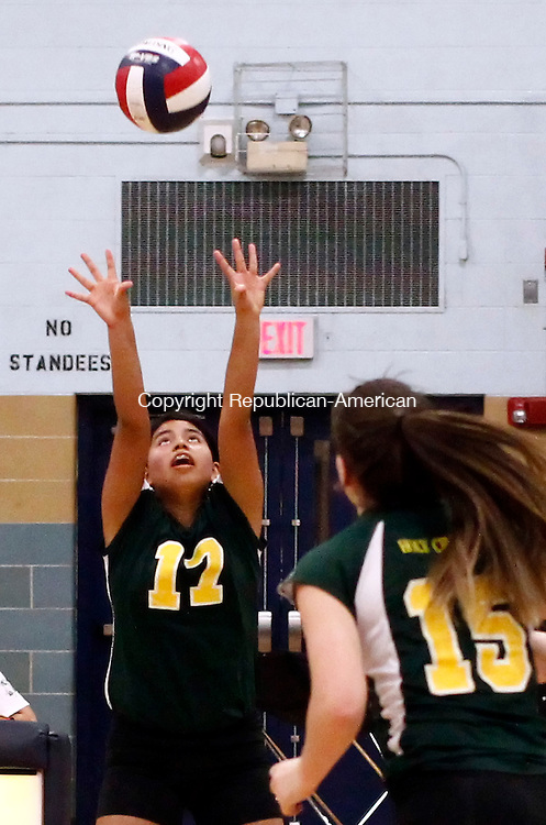 Waterbury, CT- 25 September 2014-092514CM13- Holy Cross' Gabrielle Goldman sets the ball during their NVL volleyball matchup against Kennedy on Thursday. Looking on in the play is teammate Caitlin Cipriano (15).  Kennedy would go on to win, 3-0.  Christopher Massa Republican-American