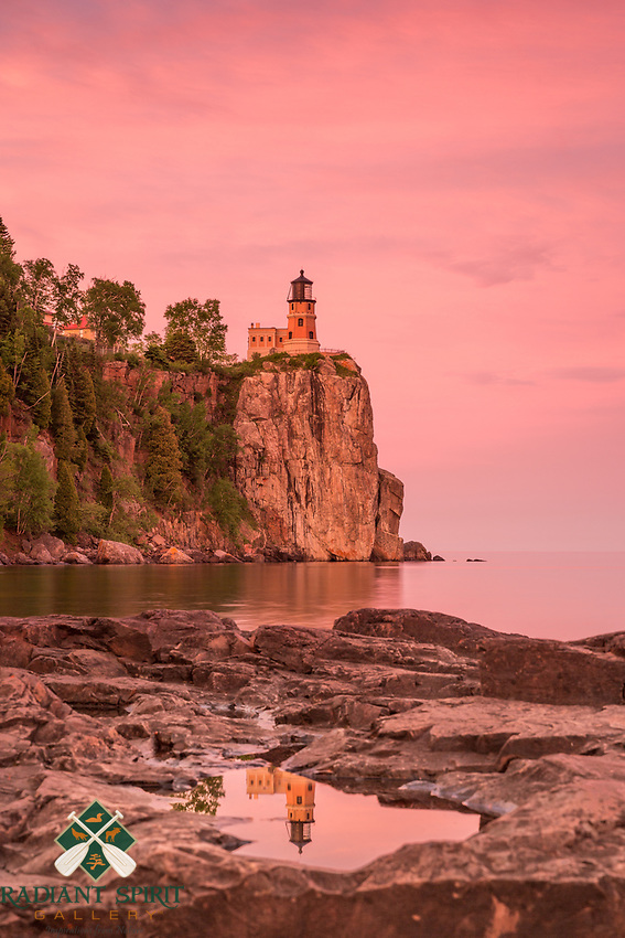&quot;Sunset Reflection at Split Rock Lighthouse&quot;<br /> <br /> On a beautiful, calm evening, we explored Lake Superior's shoreline in search of treasures around Split Rock Lighthouse. The experience was rich, standing beneath the blushing skies and listening to the accompaniment of frogs and gently lapping waves.