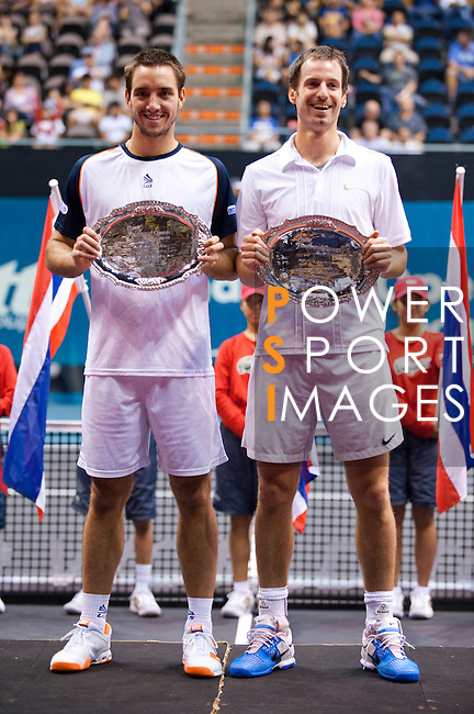 BANGKOK, THAILAND - OCTOBER 03:  Viktor Troicki of Serbia and Christopher Kas of Germany pose with trophy after victory on their doubles match against Jonathan Erlich of Israel and Jurgen Melzer of Austria during the Day 9 of the PTT Thailand Open at Impact Arena on October 3, 2010 in Bangkok, Thailand.  Photo by Victor Fraile / The Power of Sport Images