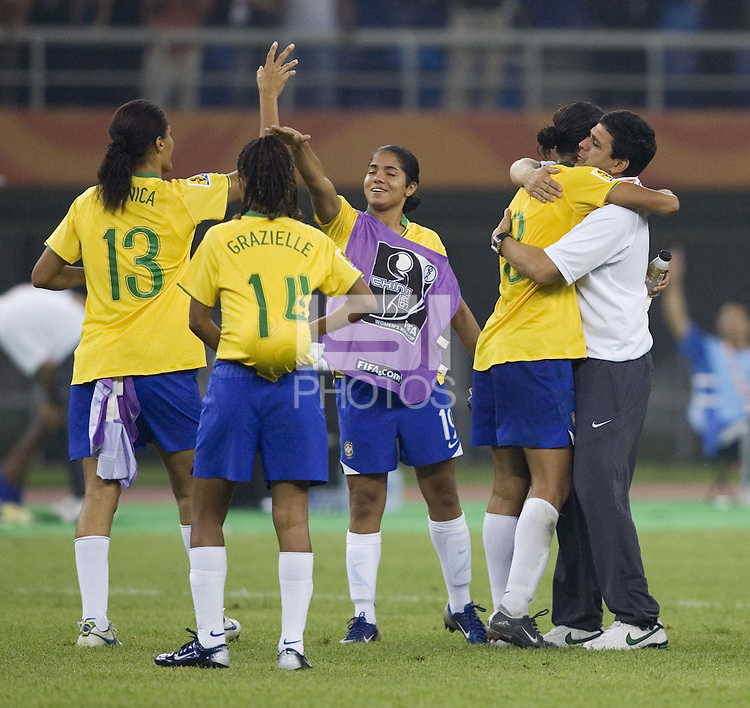 Brazil head coach Jorge Barcellos hugs defender (3) Aline after the match. Brazil defeated Australia, 3-2 during the quarterfinals of the FIFA Women's World Cup at Tianjin Olympic Center Stadium in Tianjin, China on September 23, 2007.