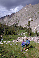 Couple hiking in the Eagles Nest Wilderness Area, Gore Mountain Range, Summit County, CO. Summit County, Colorado.
