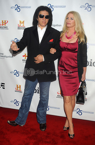 Gene Simmons and Shannon Tweed at the 2009 A&E New York Upfront at The Rainbow Room in New York City. May 14, 2009. Credit: Dennis Van Tine/MediaPunch