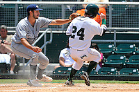 5 June 2010:  FIU's Aaron Arboleya (29) attempts to tag out Dartmouth's Chris O'Dowd (24) at the plate after a wild pitch in the third inning as the Dartmouth Green Wave defeated the FIU Golden Panthers, 15-9, in Game 3 of the 2010 NCAA Coral Gables Regional at Alex Rodriguez Park in Coral Gables, Florida.