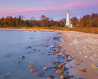 Alcona County, MI: Sunrise at Sturgeon Point Lighthouse (1870) on Lake Huron in autumn