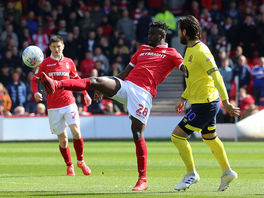 Nottingham Forest's Pele gets the ball away from Blackburn Rovers' Danny Graham<br /> <br /> Photographer David Shipman/CameraSport<br /> <br /> The EFL Sky Bet Championship - Nottingham Forest v Blackburn Rovers - Saturday 13th April 2019 - The City Ground - Nottingham<br /> <br /> World Copyright © 2019 CameraSport. All rights reserved. 43 Linden Ave. Countesthorpe. Leicester. England. LE8 5PG - Tel: +44 (0) 116 277 4147 - admin@camerasport.com - www.camerasport.com