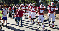 Stanford Football fans greet players before Saturday's, November 23, 2013, Big Game at Stanford University.