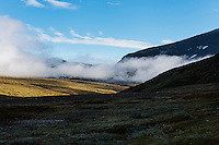 Clouds hang low in Syterskalet mountain valley near Viterskals hut, Kungsleden trail, Lapland, Sweden