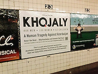 A poster in the subway in New York seeks to remind riders of the Khojaly massacre which happened 22 years ago on February 25-26 1992, seen on Tuesday, February 18, 2014 in the West 23rd Street station. Hundreds of ethnic Azerbaijani civilians in the town of Khojaly were massacred by Armenian and CIS armed forces during the Nagorno-Karabakh War (aka Armenia-Azerbaijan War). The advertisement was produced by the Azerbaijan America Alliance group. (© Richard B. Levine)