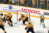 June 5th 2017, Nashiville, TN, USA;  Nashville Predators goalie Pekka Rinne (35) tries to make a save during Game 4 of the Stanley Cup Final between the Nashville Predators and the Pittsburgh Penguins, held on June 5, 2017, at Bridgestone Arena in Nashville, Tennessee.