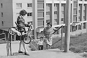 Mum and grandma taking a little one out to play, Wester Hailes, Scotland, 1979.  John Walmsley was Photographer in Residence at the Education Centre for three weeks in 1979.  The Education Centre was, at the time, Scotland's largest purpose built community High School open all day every day for all ages from primary to adults.  The town of Wester Hailes, a few miles to the south west of Edinburgh, was built in the early 1970s mostly of blocks of flats and high rises.