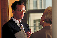 Man and woman discussing business. Close up of man. Professionals. Lawyers. Businessman. Denver Colorado USA.